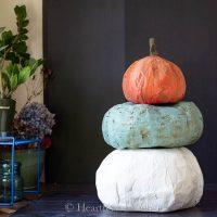 Three paper mache pumpkin topiary