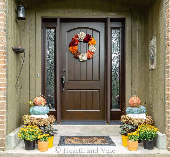 Front porch fall decor with pumpkin topiary