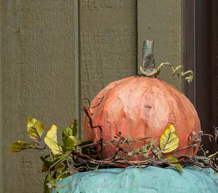 Top pumpkin on topiary with stem