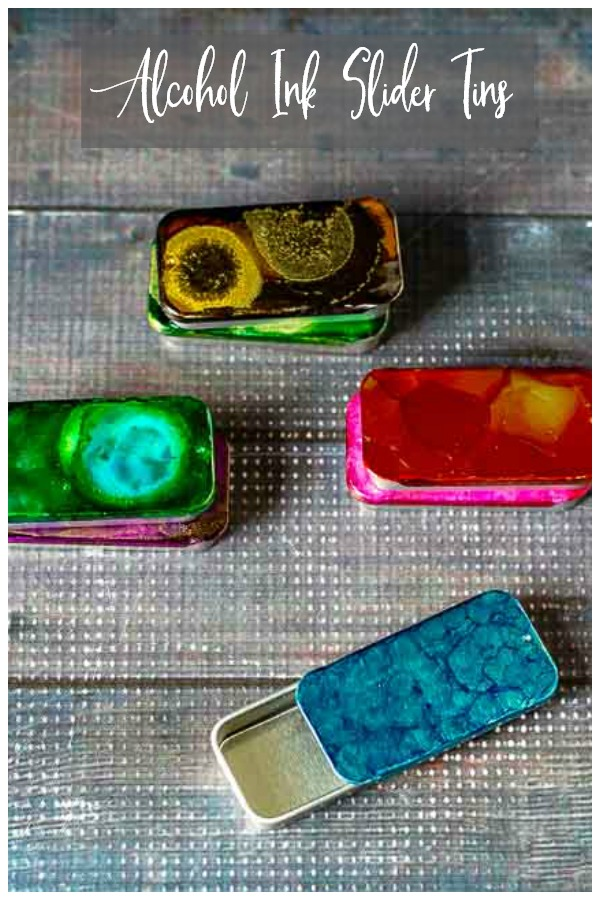 4 slider tins decorated with alcohol inks