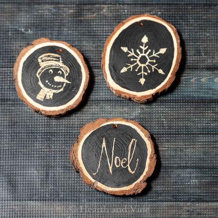 Tree wood slice ornaments - snowman, snowflake and Noel.
