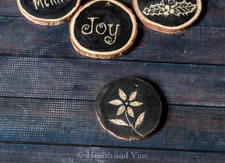 Wood slice Christmas decoration with flower engraved.