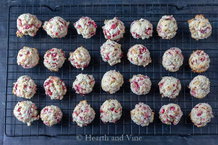 Fresh cranberry pistachio cookies on drying rack.