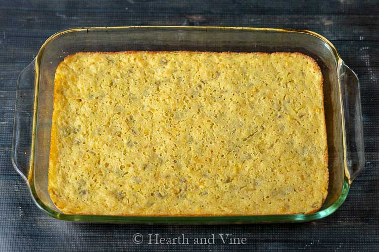 spicy green chile corn casserole in a glass 13 x 9 dish