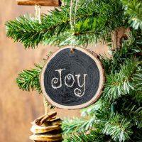 Joy Christmas Wooden Ornament on tree