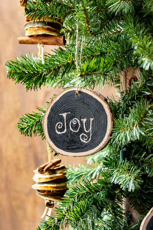 Joy Christmas Wooden Ornament on tree