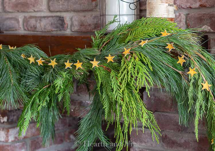 Natural lemon peel star garland on right side of mantel