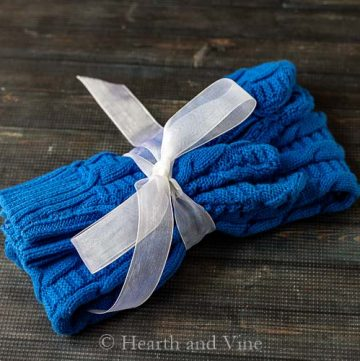 Mittens and headband tied with ribbon