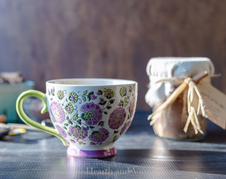 Purple and green floral mug