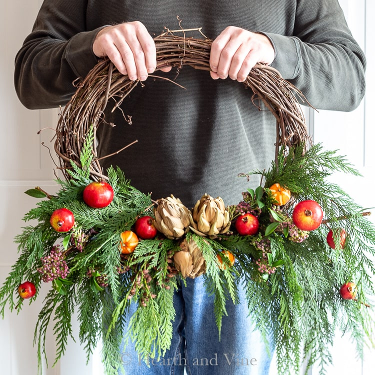 Winter wreath with fresh and faux materials