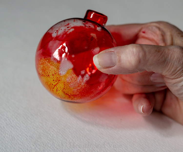 Red and yellow alcohol ink ornament