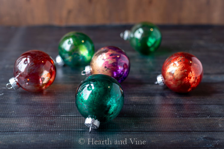Alcohol ink ornaments on table
