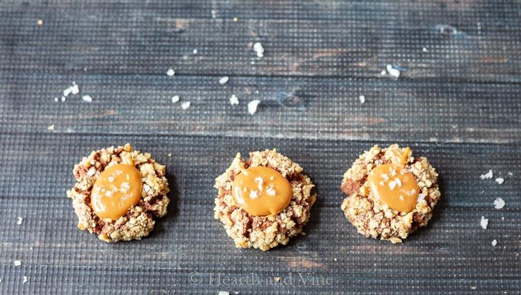 Three chocolate salted caramel thumbprint cookies