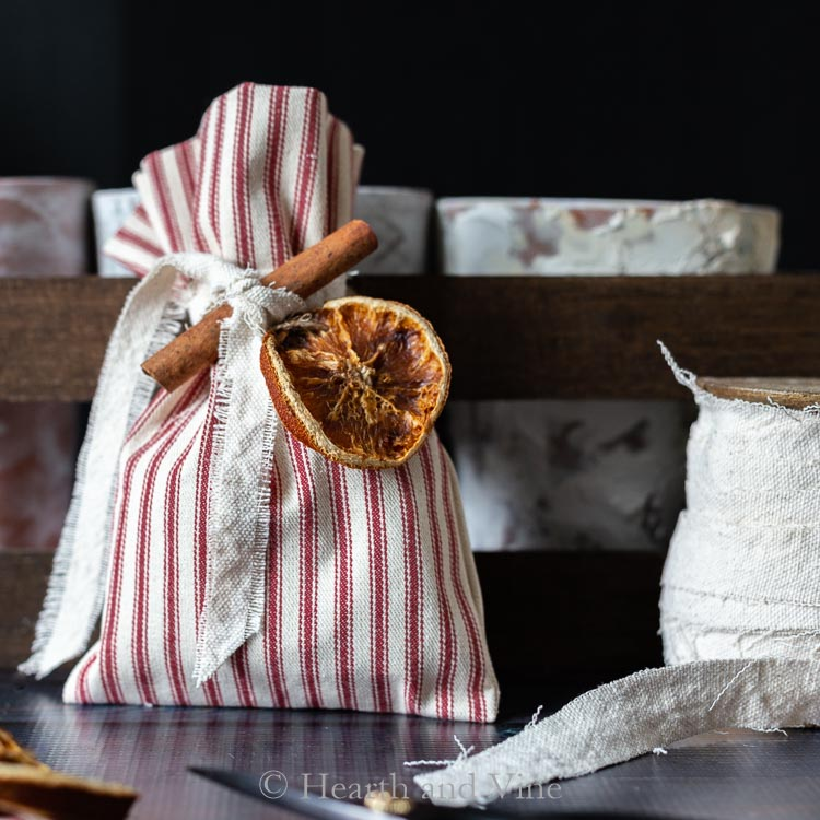 Christmas treat bag decorated with orange slice & cinnamon