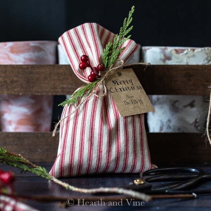 Christmas treat bag decorated with greens and berries