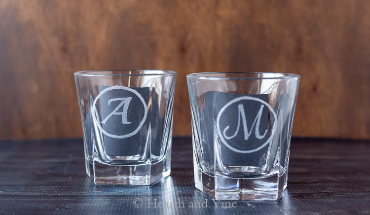 Two etched glasses with black paper