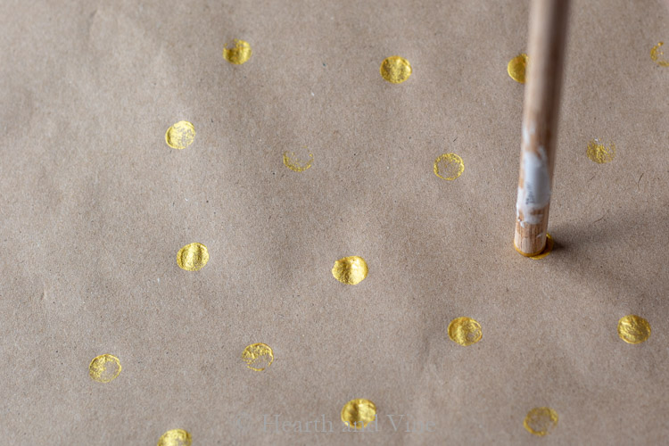 Dots of gold with dowel rod