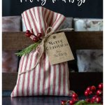 Red and white striped treat bag with Merry Christmas tag