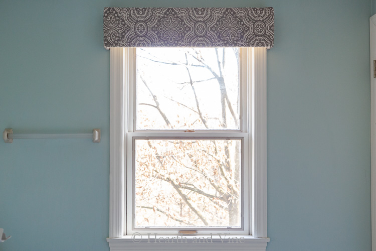 Fabric covered window cornice.