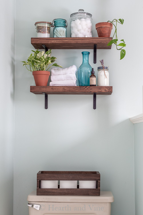 Wood shelves above toilet