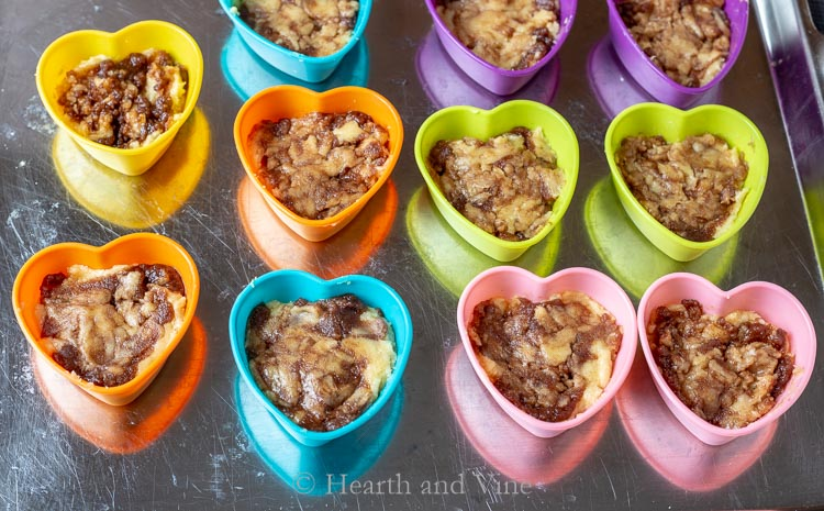 Heart cups with batter and cinnamon sugar swirled together
