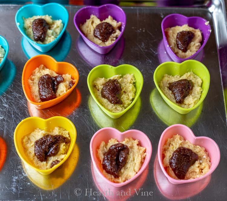 Heart baking cups with batter and cinnamon sugar