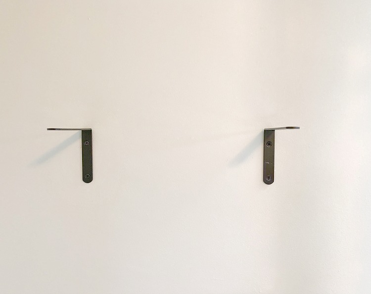 Wood shelf brackets on wall