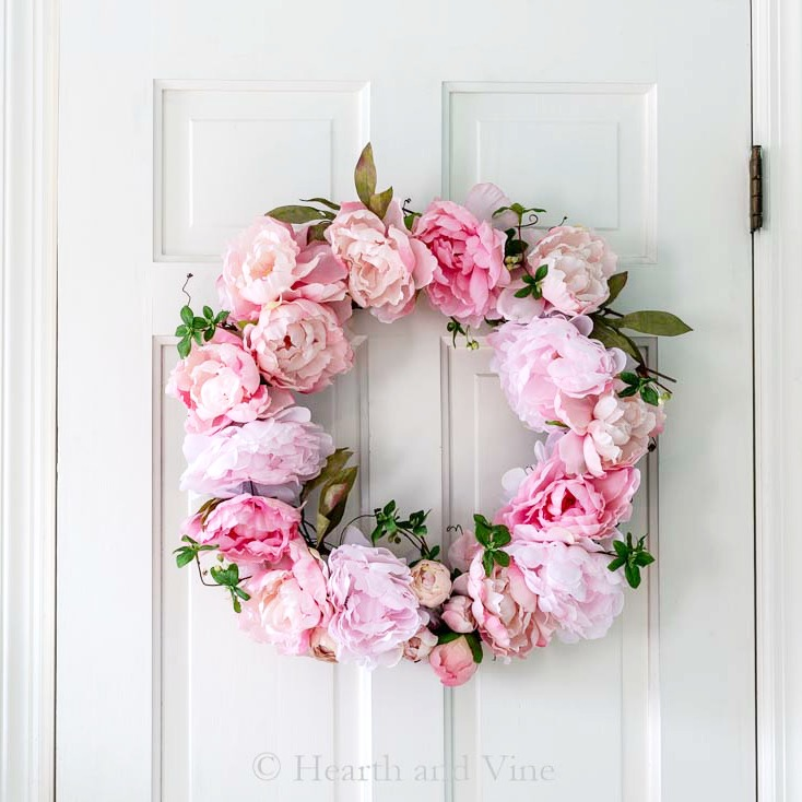 spring peony grapevine wreath on white door