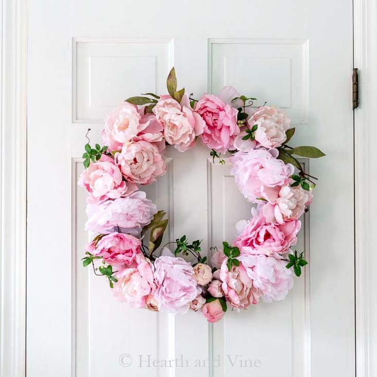 spring peony grapevine wreath on white door