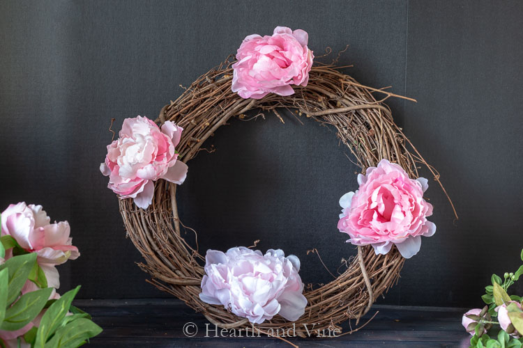 Four peonies on grapevine wreath