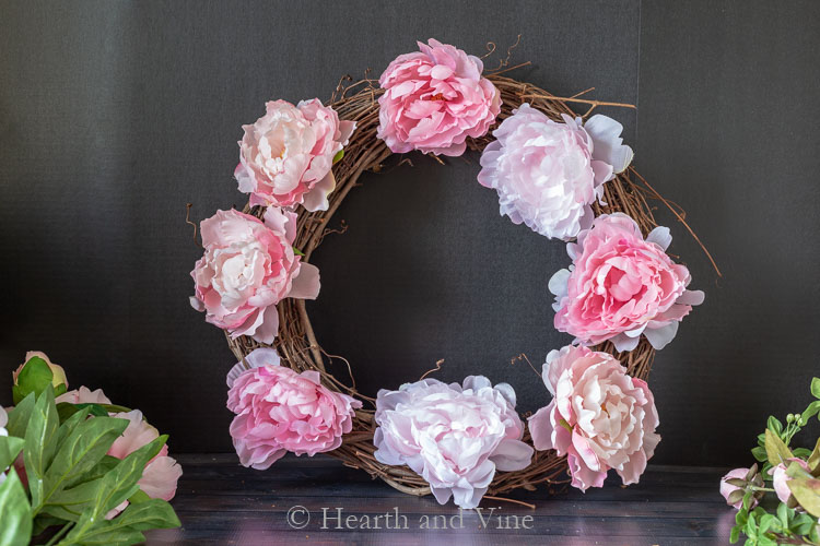 Eight peonies on grapevine wreath