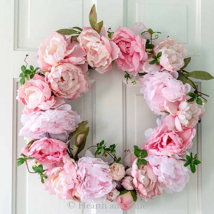 DIY spring peony wreath on white door