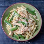 Creamy red pepper sauce pasta with chicken and snap peas