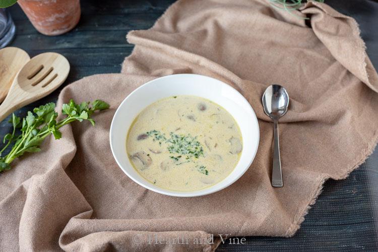 bowl of cream of mushroom soup on table