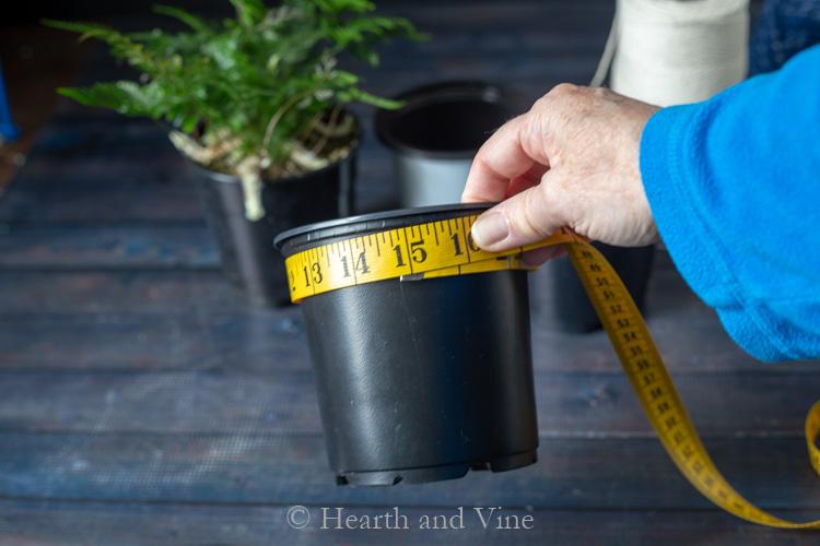 Nursery pot and tape measure