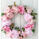 Spring peony wreath on white door