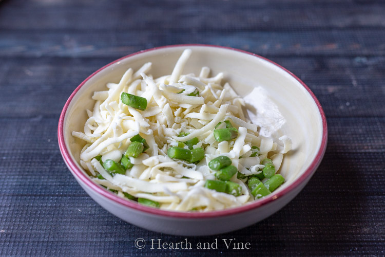 Asparagus and cheese in bowl