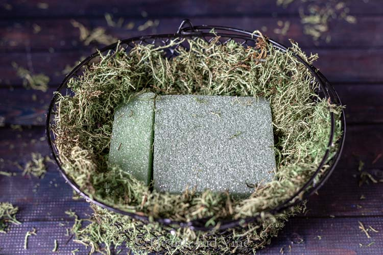foam in moss covered basket