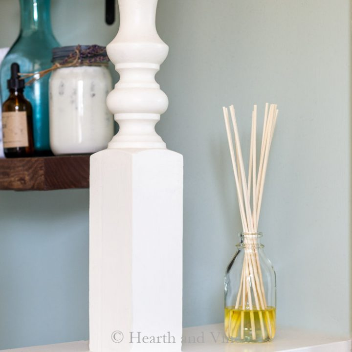 Homemade reed diffuser on shelf.