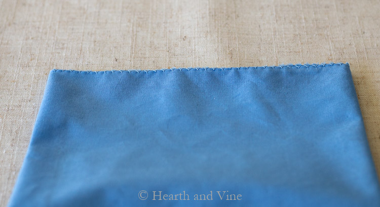Overcast stitch on blue napkin