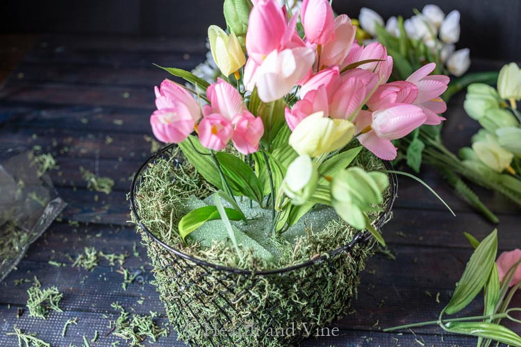 flowers being placed in basket