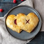 2 heart shaped raspberry pies