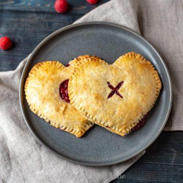 2 heart shaped raspberry pies