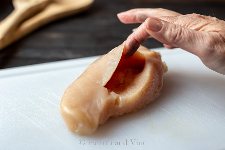 Raw chicken breast with cut pocket