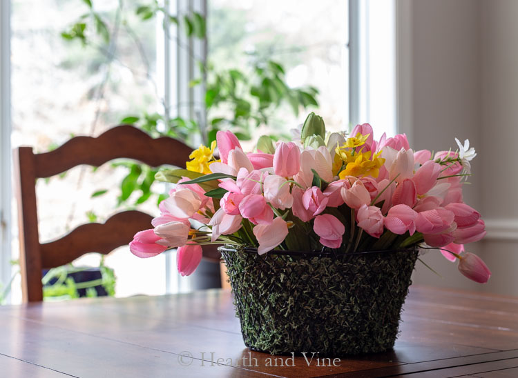 Spring flowers baskets on table