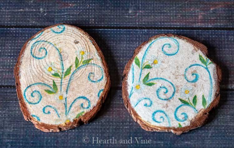 Two decoupaged coasters with different napkin thickness