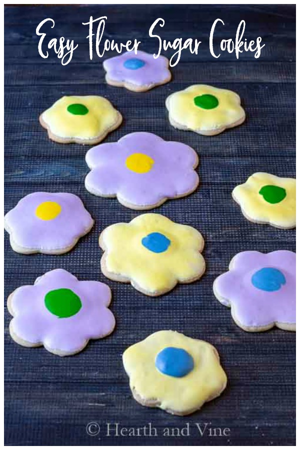 Different colored flower sugar cookie on cooling rack