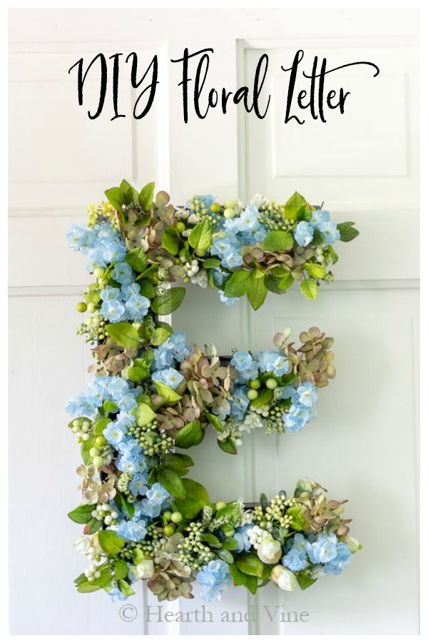 Green and blue floral letter E on door