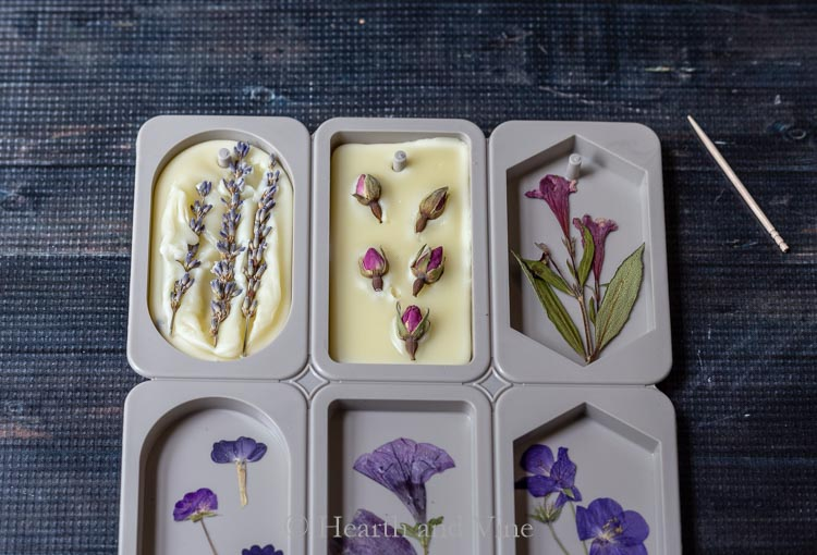 Pressed flowers and wax in molds