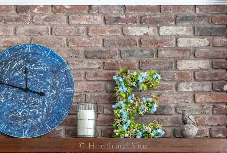 Floral letter E on mantel